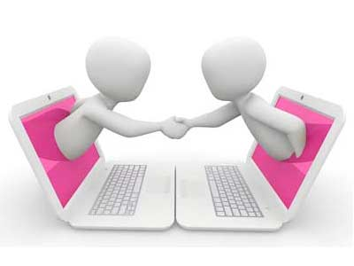 Digital cartoon of two people shaking hands coming out of laptops
