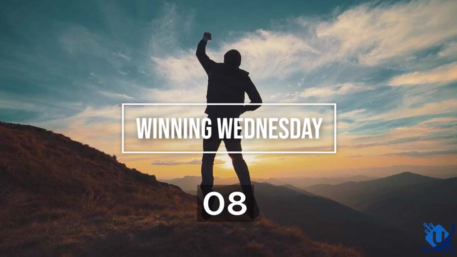 Winning Wednesday: Silhouette of man holding fist up ontop of mountain